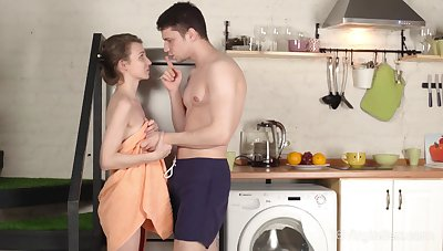 Young Russian wife Nelya is loosing her virginity in the kitchen