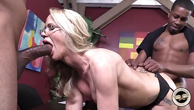 Sickly blonde takes two obese black cocks into her holes