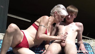 Kinky granny in hold together sucks a big hard penis of one young guy
